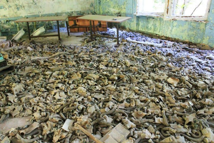 creepy room filled with gas masks