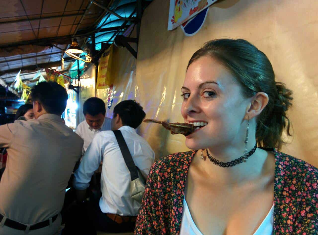 Lauren eating duck beaks in Bangkok