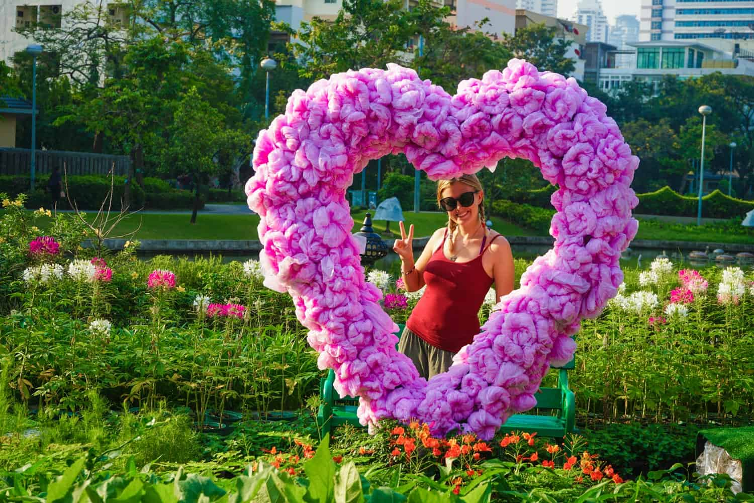 Girl in a pink heart of plastic bags