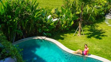 Girl next to pool at Bali villa